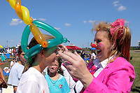 A clown makes balloon hats for fans watching the finals of the 2011 FIFA Women's World Cup prior to a Women's Professional Soccer (WPS) match between Sky Blue FC and the Western New York Flash at Yurcak Field in Piscataway, NJ, on July 17, 2011.