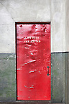 Fire Door.  Red Door. Seattle, WA, Georgetown Steam Plant, a National Historic Landmark in Seattle, WA USA