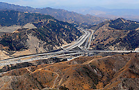 July. 10, 2009; Los Angeles, CA, USA; Overpass of the Los Angeles freeway Interstate Five 5 through the mountains. Mandatory Credit: Mark J. Rebilas