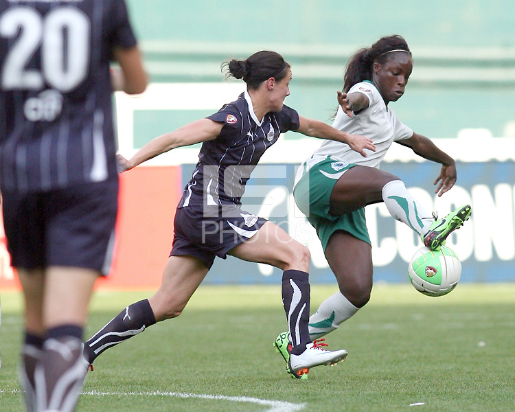 Sarah Huffman #14 of the Washington Freedom chases down Eniola Aluko #9 of St. Louis Athletica during a WPS match on May 1 2010, at RFK Stadium, in Washington D.C. Freedom won 3-1.