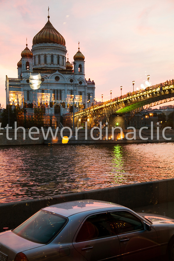 RUSSIA, Moscow. A view of the Patriarshy Bridge and the Cathedral of Christ the Saviour at night.