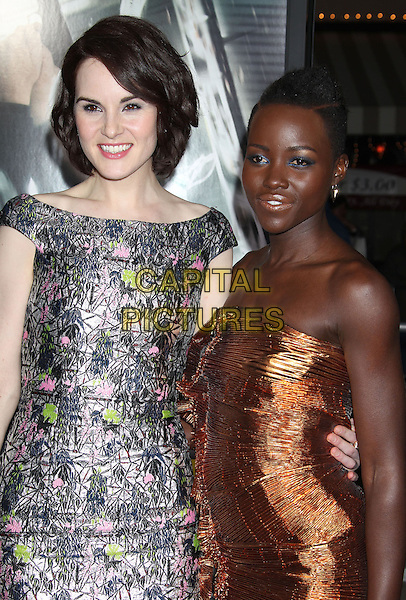 24 February 2014 - Westwood, California - Michelle Dockery, Lupita Nyong'o. &quot;Non-Stop&quot; Los Angeles Premiere held at the Regency Village Theatre. <br /> CAP/ADM/RE<br /> &copy;Russ Elliot/AdMedia/Capital Pictures