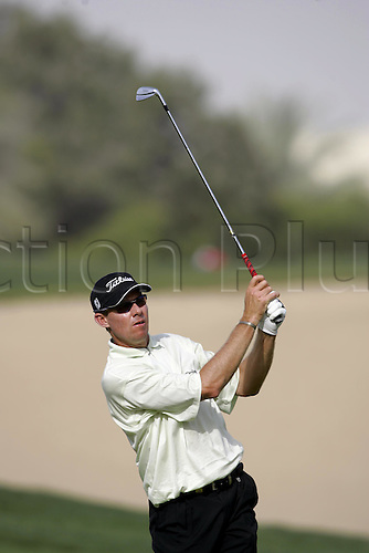 6 March 2005: South African golfer James Kingston (RSA) looks into the distance after playing an iron from the fairway during the fourth round of the Dubai Desert Classic held on the Majlis Course at the Emirates Golf Club, Dubai, United Arab Emirates. Photo: Neil Tingle/actionplus..050306 golf man men male player