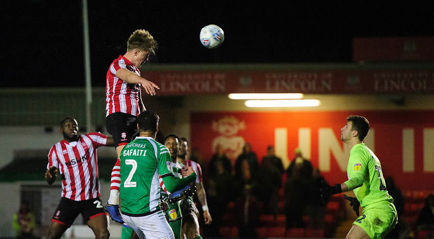 Lincoln City's Mark O'Hara scores the opening goal<br /> <br /> Photographer Chris Vaughan/CameraSport<br /> <br /> The EFL Sky Bet League Two - Lincoln City v Yeovil Town - Friday 8th March 2019 - Sincil Bank - Lincoln<br /> <br /> World Copyright © 2019 CameraSport. All rights reserved. 43 Linden Ave. Countesthorpe. Leicester. England. LE8 5PG - Tel: +44 (0) 116 277 4147 - admin@camerasport.com - www.camerasport.com