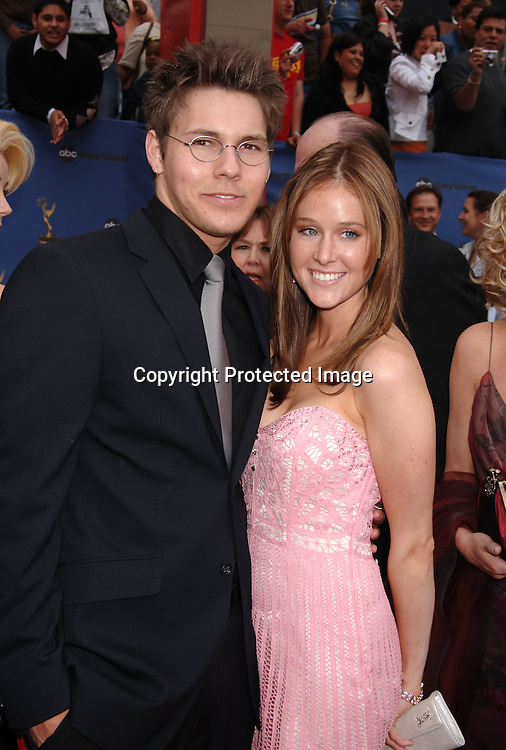 Scott Clifton and date..arriving at the 33rd Annual Daytime Emmy Awards ..on April 28, 2006 at The Kodak Theatre in Hollywood, ..Californina. ..Robin Platzer, Twin Images