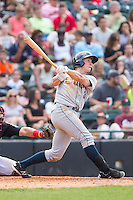 John Murphy (3) of the Charleston RiverDogs follows through on his swing against the Hickory Crawdads at L.P. Frans Stadium on May 25, 2014 in Hickory, North Carolina.  The RiverDogs defeated the Crawdads 17-10.  (Brian Westerholt/Four Seam Images)