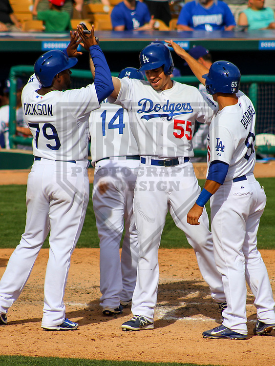 GLENDALE - March 2015: Matt Carson (55), O'Koyea Dickson (79), Kike Hernandez (14) and Austin Barnes (65) of the Los Angeles Dodgers during a spring training game against the Cleveland Indians on March 17th, 2015 at Camelback Ranch in Glendale, Arizona. (Photo Credit: Brad Krause)