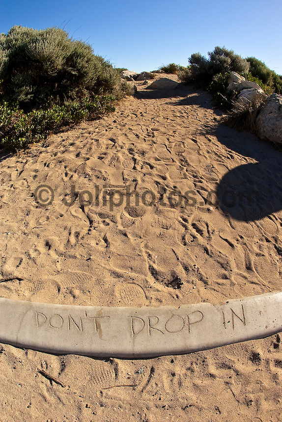 A warning to fellow surfers on a beach track.  The Margaret River area in the south west corner of Western Australia. Photo: joliphotos.com