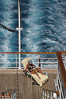 Cruising offers passengers an opportunity to catch up on their reading and relaxation.  This image was taken in the western Carribean aboard the Celebrity Cruise Ship Zenith...Cruising, Carribean, blue water, reading, relaxing, enjoyment
