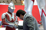 February 7, 2013, Tokyo, Japan - A visitor shakes hands with Ultraman at TIGS in Tokyo.  The 75th Tokyo International Gift Show (TIGS) is an exhibition of personal gifts, consumer goods and decorative accessories. The TIGS is the largest International Trade Show in Japan, and held semi-annually, each Spring and Autumn at Tokyo Big Sight.  The exhibition is held on February 6 to 8. (Photo by Rodrigo Reyes Marin/AFLO)..