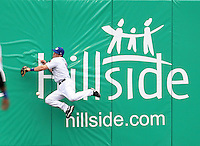 Buffalo Bisons outfielder Vinny Rottino #4 crashes into the wall attempting to catch a fly ball during a game against the Pawtucket Red Sox at Coca-Cola Field on April 15, 2012 in Buffalo, New York.  Buffalo defeated Pawtucket 10-9 in ten innings.  (Mike Janes/Four Seam Images)