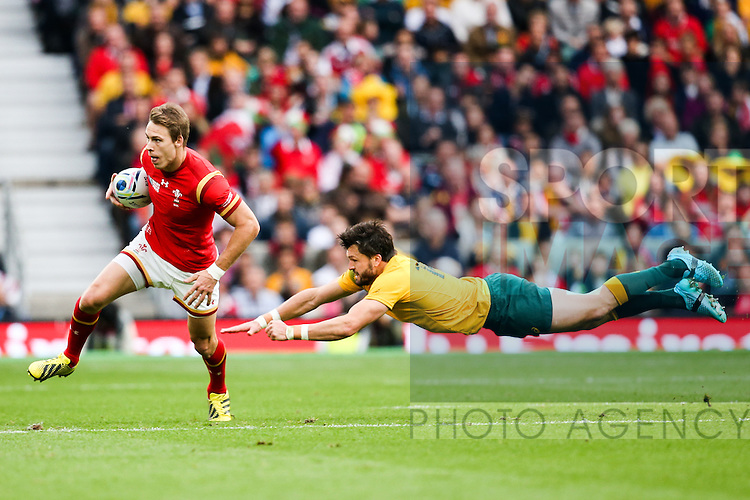 Wales' Liam Williams breaks Australia's Adam Ashley-Cooper's tackle - Rugby World Cup 2015 - Pool A - Australia v Wales - Twickenham Stadium - London- England - 10th October 2015 - Picture Charlie Forgham Bailey/Sportimage