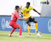 PHILADELPHIA, PA - JUNE 30: Kemar Lawrence #20 and Edgar Barcenas #10 battle for the ball during a game between Panama and Jamaica at Lincoln Financial Field on June 30, 2019 in Philadelphia, Pennsylvania.