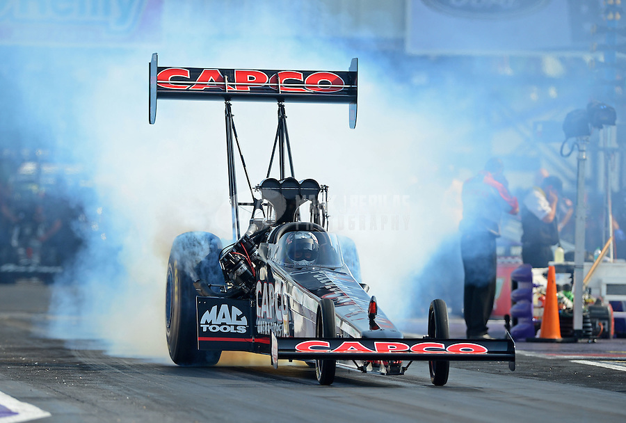 Apr. 27, 2012; Baytown, TX, USA: NHRA top fuel dragster driver Steve Torrence during qualifying for the Spring Nationals at Royal Purple Raceway. Mandatory Credit: Mark J. Rebilas-