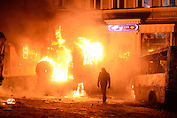 Rioters torch police trucks  using  molotov cocktails during the   protest against new draconian law to ban the right to  protest across the country.  Kiev. Ukraine