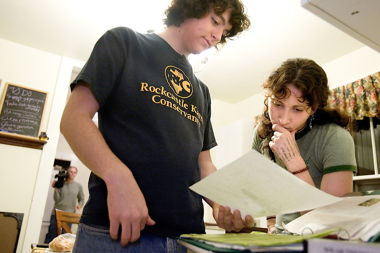 Nathan Jud and Hallie Morris, two of three residents at Ohio University's Ecohouse, talk about landscaping plans at the house on Monday, 9/25/06.