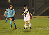 Lewis Morgan gets away from Lewis Spence in the St Mirren v Dunfermline Athletic Scottish Professional Football League Under 20 match played at the Excelsior Stadium, Airdrie on 11.12.13.