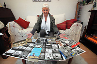 Pictured: Pat Stewart at her home in Llantwit Major with a selection of items bearing the iconic image taken by Bert Hardy and other mementos from the same era. <br /> Re: 77 year old Pat Stewart (nee Wilson) who now lives near Llantwit Major in the Vale of Glamorgan, south Wales claims she is one of the two young ladies in an iconic image taken by photographer Bert Hardy at Blackpool Promenade in July 1951, alongside fellow Tiller girl Wendy Clarke. Stewart is alleging that another woman, Norma Edmondson who has been claiming that it is her in the picture, is a fraud.