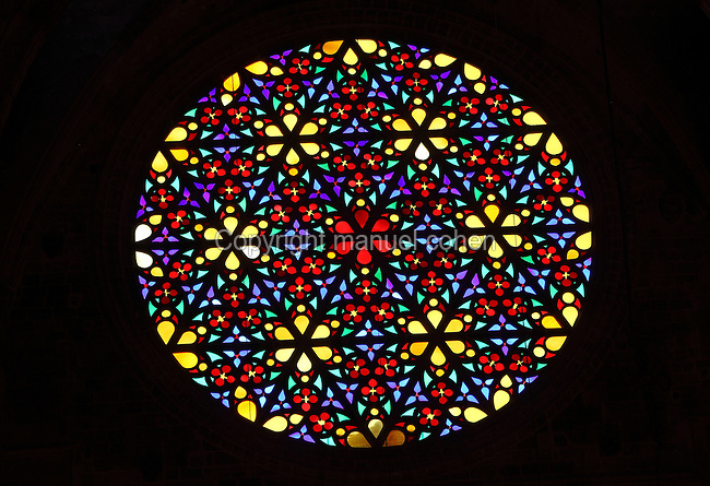 Rose window above the choir, Cathedral of Santa Maria of Palma or La Seu, Palma de Mallorca, Majorca, Balearic Islands, Spain. This is one of 5 rose windows in the cathedral and has a diameter of 11.3m. The original fell in 1581, it was repaired in 1857 and again in 1904 under Antoni Gaudi, but was damaged in the Spanish Civil War and finally repaired in 1946. The Roman Catholic cathedral itself was built on the site of a mosque and is a huge building in Catalan Gothic style. It was begun by King James I of Aragon in 1229 and finished in 1601. It towers over the old city of Palma overlooking the Mediterranean Sea. Picture by Manuel Cohen