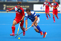 Scotland's Timothy Atkins in action against Seunghoon Lee of Korea during the Hockey World League 9th and 10th placing match between Korea and Scotland at the Olympic Park, London, England on 22 June 2017. Photo by Steve McCarthy.