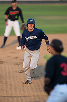 Kenny Corey (10) of the Helena Brewers hustles towards third base against the Great Falls Voyagers at Centene Stadium on August 18, 2017 in Helena, Montana.  The Voyagers defeated the Brewers 10-7.  (Brian Westerholt/Four Seam Images)