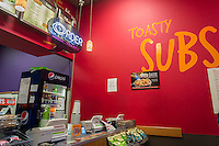A  Quiznos franchise in New York on Monday, February 24, 2014. Avenue Capital, the owner of the sandwich chain, is in talks to restructure $600 million in debt. The lenders gave the chain until February 28 to settle with its creditors. Quiznos has 2300 stores compared to competitor Subway with 26,000 stores in the US alone. (© Richard B. Levine)