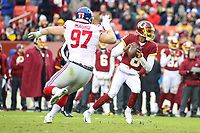 Landover, MD - December 9, 2018: New York Giants defensive end Josh Mauro (97) pressures Washington Redskins Josh Johnson (8) during the  game between New York Giants and Washington Redskins at FedEx Field in Landover, MD.   (Photo by Elliott Brown/Media Images International)