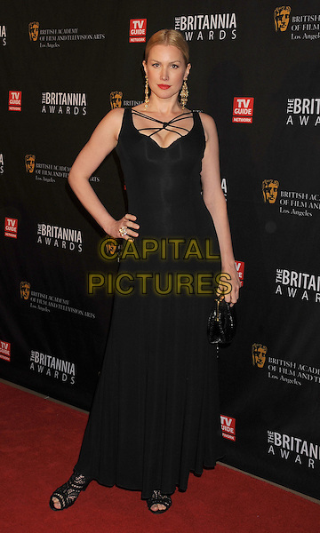 Alice Evans.BAFTA Los Angeles 2011 Britannia Awards held at the Beverly Hilton Hotel, Beverly Hills, California, USA..November 30th, 2011.full length dress hand on hip clutch bag black straps .CAP/ROT/TM.©Tony Michaels/Roth Stock/Capital Pictures