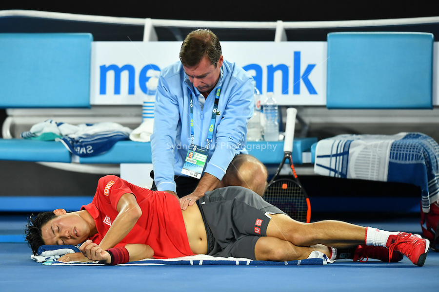 January 22, 2017: Kei Nishikori of Japan receives treatment a 4th round match against Roger Federer of Switzerland on day seven of the 2017 Australian Open Grand Slam tennis tournament in Melbourne, Australia. Photo Sydney Low