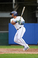 Princeton Rays first baseman Jean Ramirez (27) follows through on a swing during the second game of a doubleheader against the Greeneville Reds on July 25, 2018 at Hunnicutt Field in Princeton, West Virginia.  Greeneville defeated Princeton 8-7.  (Mike Janes/Four Seam Images)