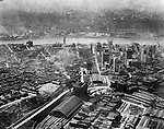 Pittsburgh PA:  Aerial view of Pittsburgh looking southwest over the Pennsylvania Railroad Station toward the Monongahela River, the South Side and new Liberty Tunnels under construction - 1923