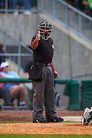 Umpire Nestor Ceja makes a call during game one of a double header between the San Antonio Missions and NW Arkansas Naturals on May 30, 2015 at Arvest Ballpark in Springdale, Arkansas.  San Antonio defeated NW Arkansas 5-1.  (Mike Janes/Four Seam Images)