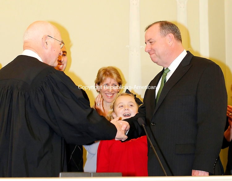 Waterbury, CT-30 November 2011-113011CM19-  Waterbury Mayor Neil M. O'Leary shakes hands with chief Justice William Sullivan after being sworn in office at City Hall in Waterbury Thursday morning.   With Mayor O'Leary are his wife Kathy, daughter Maggie, 10 and son Patrick (left and hidden.) Christopher Massa Republican-American