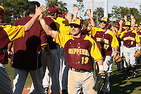March 7, 2010:  Billy Anderson (13) of the Central Michigan Chippewas leads the congratulations after a game at Jay Bergman Field in Orlando, FL.  Central Michigan defeated Central Florida by the score of 7-4.  Photo By Mike Janes/Four Seam Images
