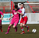 Airdrie's Scott Fraser and Stirling's Willie Robertson challenge for the ball.