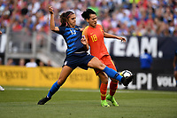 Cleveland, Ohio - Tuesday June 12, 2018: Alex Morgan, Han Peng during an international friendly match between the women's national teams of the United States (USA) and China PR (CHN) at FirstEnergy Stadium.
