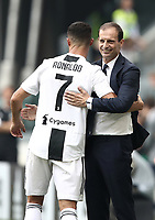 Calcio, Serie A: Juventus - Sassuolo, Turin, Allianz Stadium, September 16, 2018.<br /> Juventus' Cristiano Ronaldo (l) celebrates with his coach Massimiliano Allegri (r) after scoring his first goal during the Italian Serie A football match between Juventus and  Sassuolo at Torino's Allianz stadium, September 16, 2018.<br /> UPDATE IMAGES PRESS/Isabella Bonotto