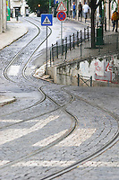 Tram tracks. At Miradouro de Santa Luzia. Street view. Alfama district. Lisbon, Portugal