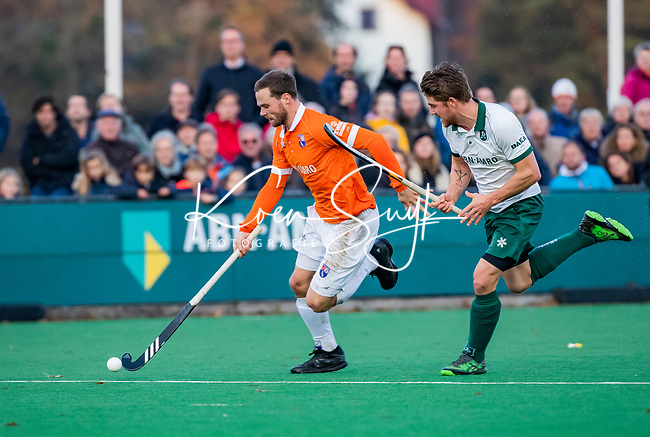 BLOEMENDAAL - Roel Bovendeert (Bldaal) met Timo Goor (R'dam) tijdens  hoofdklasse competitiewedstrijd  heren , Bloemendaal-Rotterdam (1-1) .COPYRIGHT KOEN SUYK