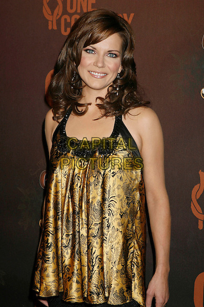 "MARTINA McBRIDE.Arrivals at ""CMT Giants"" Honoring Reba McEntire held at the Kodak Theatre, Hollywood, LA, California, USA,.26 October 2006..half length gold and black top.Ref: ADM/RE.www.capitalpictures.com.sales@capitalpictures.com.©Russ Elliot/AdMedia/Capital Pictures."