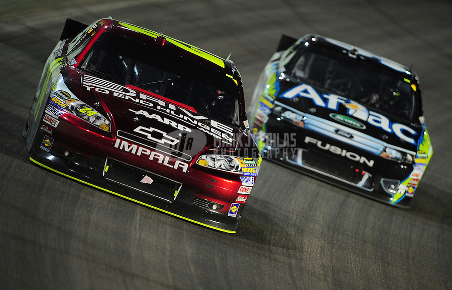 Nov. 20, 2011; Homestead, FL, USA; NASCAR Sprint Cup Series driver Jeff Gordon (24) leads Carl Edwards (99) during the Ford 400 at Homestead Miami Speedway. Mandatory Credit: Mark J. Rebilas-