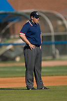 Umpire Drew Ashcraft works the bases during a Carolina League game between the Potomac Nationals and the Winston-Salem Dash at Wake Forest Baseball Park May 10, 2009 in Winston-Salem, North Carolina. (Photo by Brian Westerholt / Four Seam Images)
