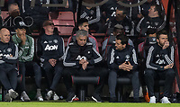 Man Utd Manager Jose Mourinho sets his watch with Paul Pogba sitting behind him during the Premier League match between Bournemouth and Manchester United at the Goldsands Stadium, Bournemouth, England on 18 April 2018. Photo by Andy Rowland.