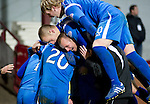 Hearts v St Johnstone....11.01.11  Scottish Cup.Goalscorer Peter MacDonald is mobbed by Danny Grainger, Jody Morris, Liam Craig and Murray Davidson.Picture by Graeme Hart..Copyright Perthshire Picture Agency.Tel: 01738 623350  Mobile: 07990 594431