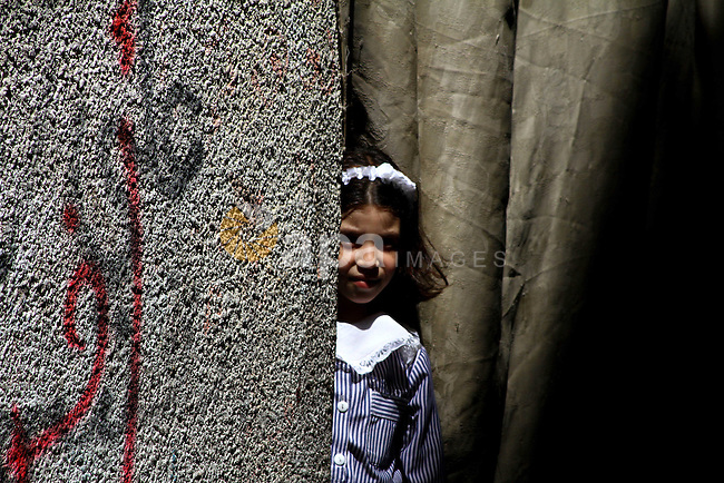 A Palestinian girl stands outside her house in al-Shate` refugee camp in Gaza City, on Sep. 15, 2011. President Mahmoud Abbas's bid to seek U.N. recognition of a Palestinian state is not generating much enthusiasm in the isolated Gaza Strip, where internal political divisions run deep. Photo by Ashraf Amra