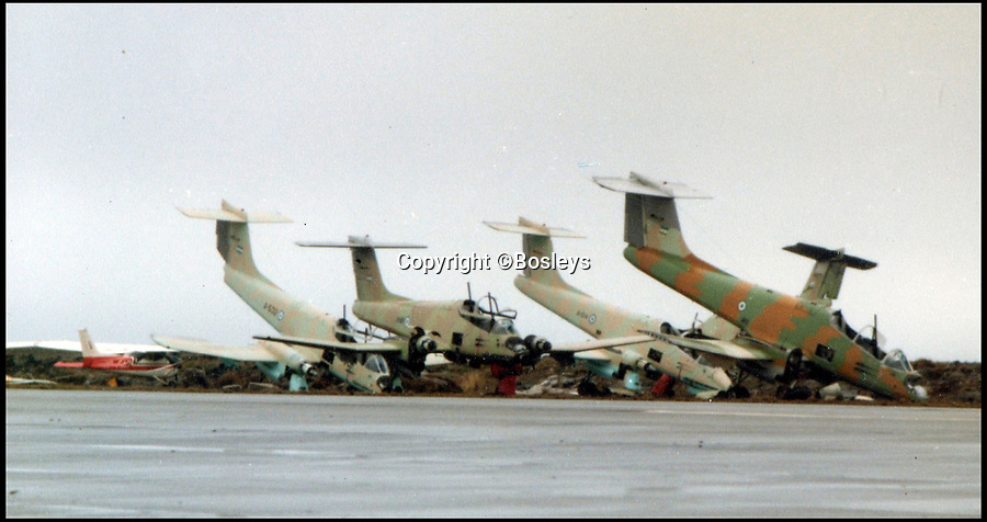 BNPS.co.uk (01202 558833)Pic: Bosleys/BNPS<br /> <br /> Argentinian jets at Port Stanley.<br /> <br /> Never-before-seen photos have emerged to show the hilarious moment Prince Andrew was mercilessly ridiculed as part of a Royal Naval initiation 36 years ago.<br /> <br /> The young officer was made to take part in a Crossing the Line ceremony to mark the first time he passed the equator as a seaman.<br /> <br /> In a nod to Prince Andrew's Royal background, the photos show him sat on makeshift throne with a cardboard crown placed on his head.<br /> <br /> Alarmingly, a seaman dressed as the barber is seen approaching the then second-in-line to the throne with a very large meat clever covered in imitation blood.
