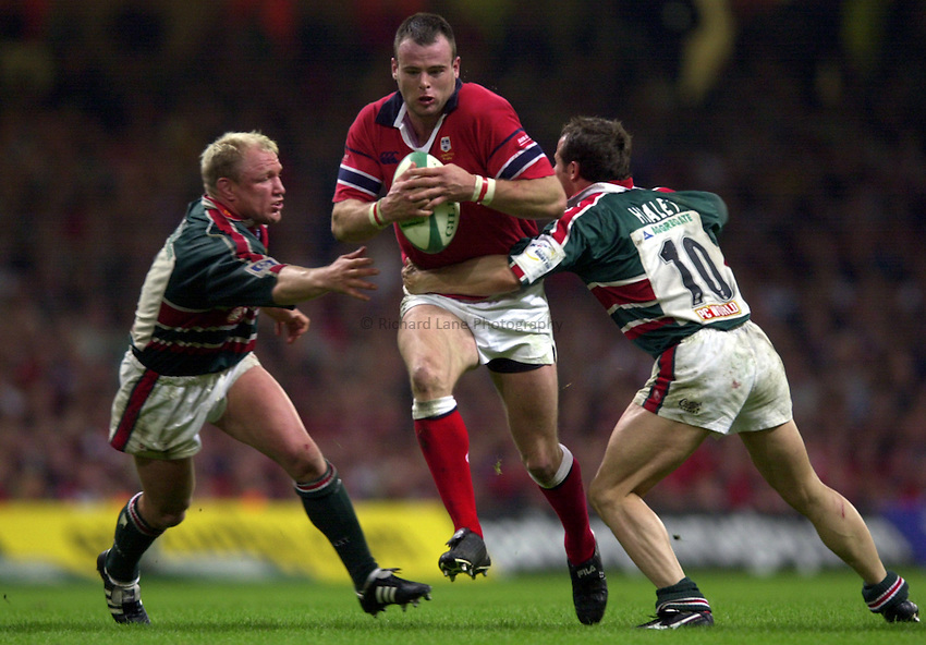 Photo: Richard Lane..Leicester Tigers v Munster. Heineken Cup Final at the Millennium Stadium. 25/05/2004..John O'Neil is tackled by Neil Back and Austin Healey.
