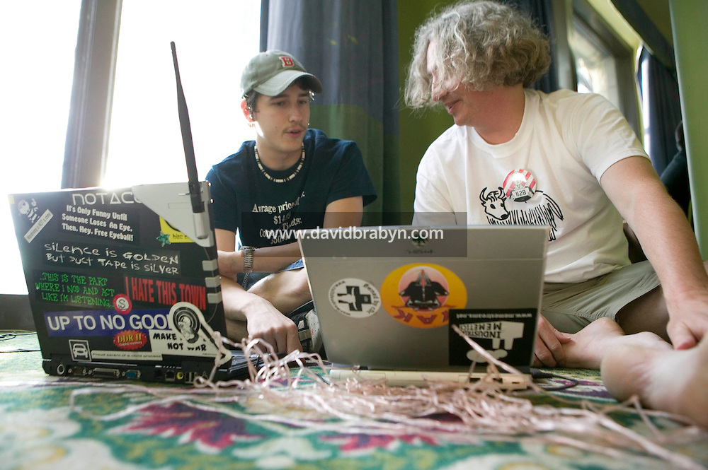 Attendees of the 6th edition of HOPE, an annual hackers' convention, configure their laptops, July 23rd 2006, New York City, USA.