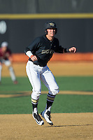 Keegan Maronpot (13) of the Wake Forest Demon Deacons takes his lead off of second base against the Florida State Seminoles at David F. Couch Ballpark on April 16, 2016 in Winston-Salem, North Carolina.  The Seminoles defeated the Demon Deacons 13-8.  (Brian Westerholt/Four Seam Images)
