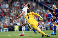 Gareth Bale of Real Madrid and Tomas Vaclik of FC Basel 1893 during the Champions League group B soccer match between Real Madrid and FC Basel 1893 at Santiago Bernabeu Stadium in Madrid, Spain. September 16, 2014. (ALTERPHOTOS/Caro Marin) /NortePhoto.com
